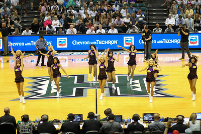 Lakers cheerleaders entertain the crowd during a time out in an NBA preseason game between the Los Angeles Lakers and the Utah Jazz at the Stan Sheriff Center, Honolulu, HI on October 04, 2015.