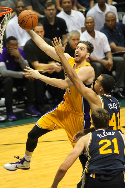 Ryan Kelly (4) of the Lakers drives on Trey Lyles (41) of the Jazz during an NBA preseason game at the Stan Sheriff Center, Honolulu, HI on October 04, 2015.