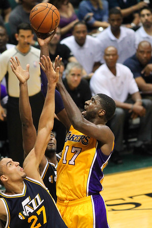 Lakers center Roy Hibbert (17) goes up against Jazz center Rudy Gobert (27) during an NBA preseason game at the Stan Sheriff Center, Honolulu, HI on October 04, 2015.