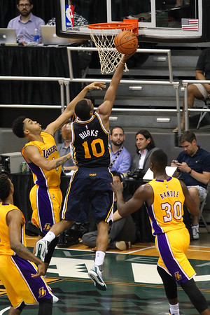 Jazz guard Alec Burks (10) drives to the rim against the defense of Lakers  D'Angelo Russell (1) and Julius Randle (30) during an NBA preseason game at the Stan Sheriff Center, Honolulu, HI on October 04, 2015.