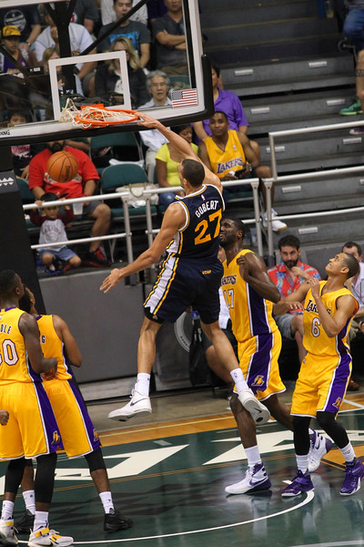 Jazz center Rudy Gobert (27) slams one home against the Lakers during an NBA preseason game at the Stan Sheriff Center, Honolulu, HI on October 04, 2015.