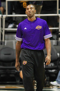 Kobe Bryant of the Los Angeles Lakers walks on the court before playing the Utah Jazz in an NBA preseason game at the Stan Sheriff Center, Honolulu, HI on October 04, 2015. This is Bryant's 20th and final season in the NBA.
