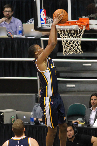 Jazz guard Rodney Hood (5) goes up for a dunk against the Lakers during an NBA preseason game at the Stan Sheriff Center, Honolulu, HI on October 04, 2015.