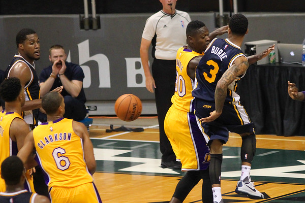 Jazz guard Trey Burke (3) goes behind the back against the Lakers during an NBA preseason game at the Stan Sheriff Center, Honolulu, HI on October 04, 2015.