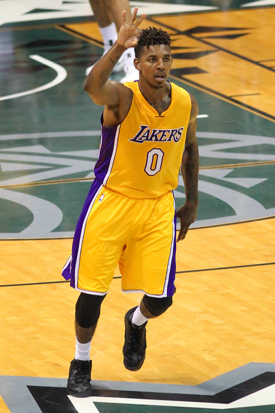 Lakers guard/forward Nick Young (0), also known as Swaggy P, celebrates a three pointer against the Utah Jazz during an NBA preseason game at the Stan Sheriff Center, Honolulu, HI on October 04, 2015.