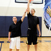 """Camp Director Geoff Golden, left, uses NBA player Louis Amundson to demonstrate the proper form for shooting a basketball on Monday, June 18, during a basketball camp at Legacy High School in Broomfield. For a video of the camp and interview with Amundson go to  <a href=""""http://www.dailycamera.com"""">http://www.dailycamera.com</a><br /> Jeremy Papasso/ Boulder Daily Camera"""