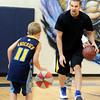 """Rocco Bridges, 7, at left, practices dribbling with NBA player Louis Amundson on Monday, June 18, during a basketball camp at Legacy High School in Broomfield. For a video of the camp and interview with Amundson go to  <a href=""""http://www.dailycamera.com"""">http://www.dailycamera.com</a><br /> Jeremy Papasso/ Boulder Daily Camera"""