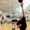"""NBA player Louis Amundson demonstrates the proper layup technique on Monday, June 18, during a basketball camp at Legacy High School in Broomfield. For a video of the camp and interview with Amundson go to  <a href=""""http://www.dailycamera.com"""">http://www.dailycamera.com</a><br /> Jeremy Papasso/ Boulder Daily Camera"""