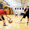 """Thomas Bounds, 11, at left, gets dribbling tips from NBA player Louis Amundson on Monday, June 18, during a basketball camp at Legacy High School in Broomfield. For a video of the camp and interview with Amundson go to  <a href=""""http://www.dailycamera.com"""">http://www.dailycamera.com</a><br /> Jeremy Papasso/ Boulder Daily Camera"""