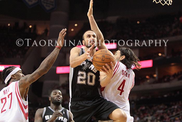 December 29, 2011; Houston, TX, USA; San Antonio Spurs guard Manu Ginobili (20) scores a layup in the third quarter against the Houston Rockets at Toyota Center. Mandatory Credit: Troy Taormina-US PRESSWIRE