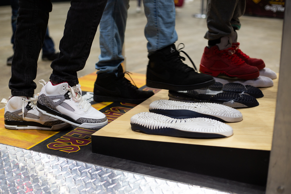 . Michael Johnson - The News-Herald Fans compare their shoe sizes to NBA players shoes during the Eastern Conference Finals watch party at the Quicken Loans Arena on May 13, 2018.