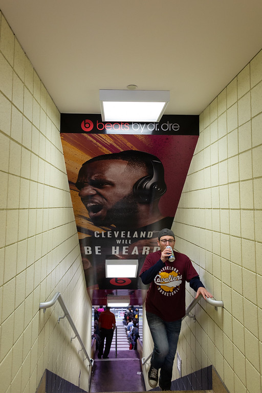 . Michael Johnson - The News-Herald Joe Placidi walks up the stairs from the court during the Eastern Conference Finals watch party at the Quicken Loans Arena on May 13, 2018.