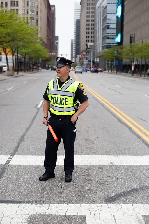 . Michael Johnson - The News-Herald A Cleveland Police Officer on crosswalk duty on May 13, 2018 outside of the Quicken Loans Arena.