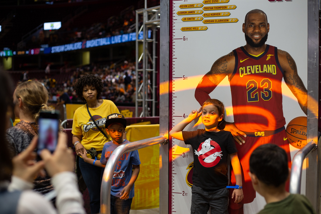. Michael Johnson - The News-Herald Cavaliers fans take pictures with a LeBron poster at the Q on May 13, 2018.