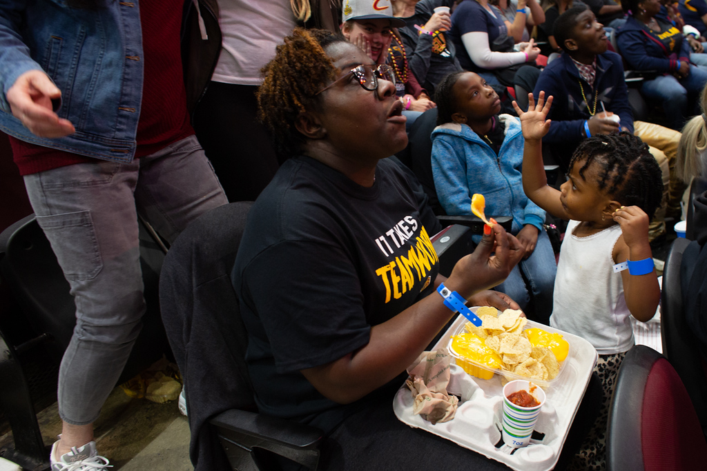 . Michael Johnson - The News-Herald Tisa (left) and Tyrah Wilson watch game 1 of the Eastern Conference Finals and eat nachos during a watch party at the Quicken Loans Arena on May 13, 2018.