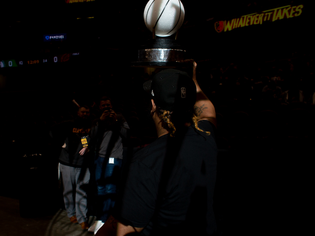 . Michael Johnson - The News-Herald Demilles Jones carries around a replica Eastern Conference Finals trophy during a watch party at the Quicken Loans Arena on May 13, 2018.