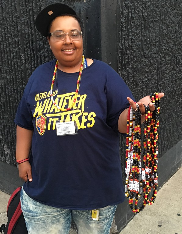 . Euclid resident Kim Goodwin, selling merchandise near The Q, Game 1 Watch Party. David S. Glasier - The News-Herald
