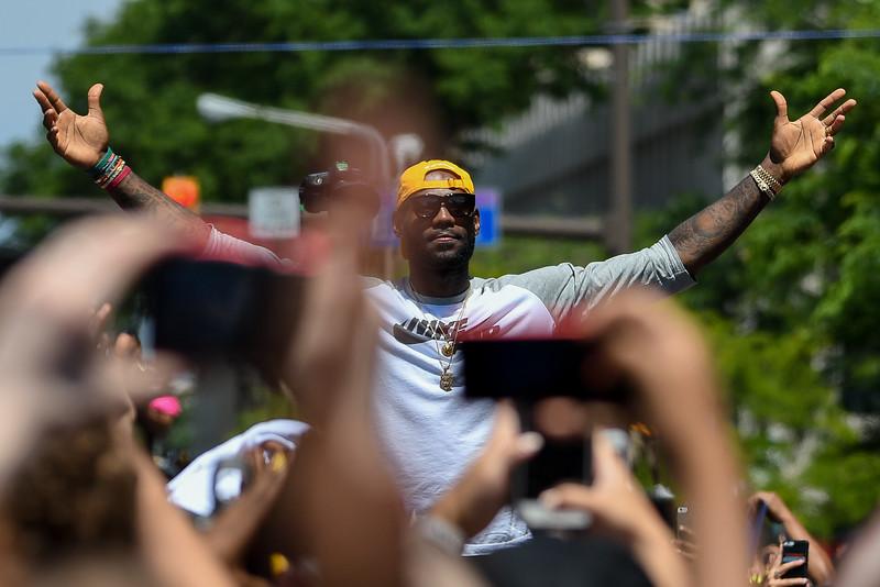 Eric Bonzar—The Morning Journal<br /> Lebron James throws his arms in the air as to embrace the crowd as he passes the final stretch of the Cavaliers Championship Parade on June 22, 2016.