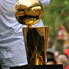 Jon Behm - The Morning Journal<br /> The Larry O'Brien Trophy started the parade alone on a table in the back of a float, but was passed around from player to player as the parade went on.