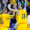 Missouri Southern State's Marquis Addison high fives teammates near the end of their NCAA Division II Central Region tournament game against Fort Hays State Saturday at Bresnan Arena in Mankato, Minn. Photo by Pat Christman