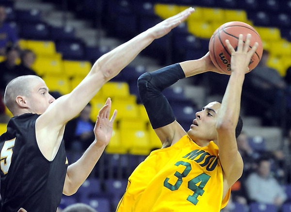 Missouri Southern State's Marquis Addison is defended by Fort Hays State's  Tomislav Gabric during the first half of a NCAA Division II Central Region basketball game Saturday at Bresnan Arena in Mankato, Minn. Photo by Pat Christman
