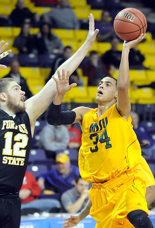Missouri Southern State's Marquis Addison shoots past Fort Hays State's Andrew Victoria during the first half of a NCAA Division II Central Region basketball game Saturday at Bresnan Arena in Mankato, Minn. Photo by Pat Christman