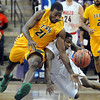 Arkansas Tech's Marshawn Arnold (21) collides with Central Missouri's Daylen Robinson while going for a loose ball during the first half Saturday at Bresnan Arena. Pat Christman