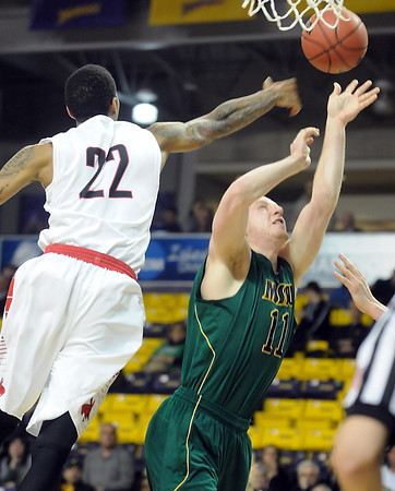 Missouri Southern State's Matt Everson has his shot blocked by Central Missouri's Charles Hammork during the NCAA Division II Central Region semifinal game Sunday at Bresnan Arena. Pat Christman