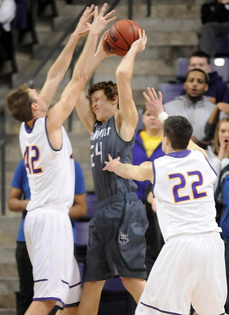 Minnesota State's Connor O'Brien (42) and Zach Monaghan (22) defend Northwest Missouri State's Conner Crooker during the second half Sunday at Bresnan Arena. Pat Christman