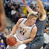 Minnesota State's Alex Hanks looks to pass around Northwest Missouri State's Zach Schneider during the first half of a NCAA Division II Central Region semifinal game Sunday at Bresnan Arena. Pat Christman
