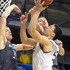 Minnesota State's Assem Marei has the ball knocked out of his hands by Northwest Missouri State's Dillon Starzl during the first half of a NCAA Division II Central Region semifinal game Sunday at Bresnan Arena. Pat Christman