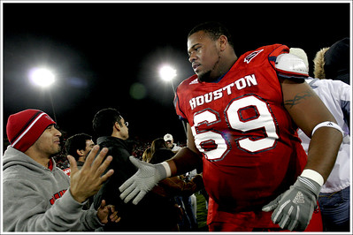 University of Houston offensive lineman Jerrod Butler shares in the celebration as fans flooded the field after the Cougars defeated Southern Miss to win the Conference USA championship December 1, 2006.