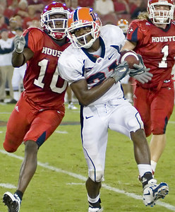 UTEP's Johnnie Lee Higgins breaks free for extra yardage after a reception against the University of Houston Cougars October 21, 2006. The Cougars scored 24 unanswered points in the second half to defeat UTEP 34-17 at Robertson Stadium in Houston.