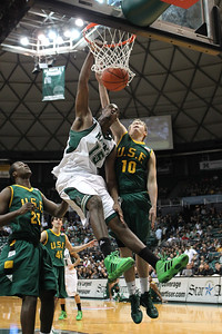 Hawaii's Vander Joaquim (15) throws down a dunk against the San Francisco Dons in the CollegeInsider.com postseason tournament at the Stan Sheriff Center, Honolulu, Hawaii on March 29, 2011. Joaquim was a 6-10 center out of Luanda, Angola who famously walked off the court in the second half of a game in 2013, thereby ending his UH career.