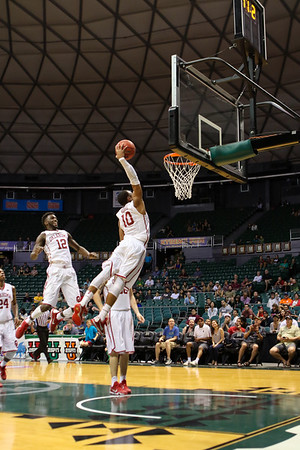 Oklahoma guard Jordan Woodard (10) caps off an 83-71 win over Harvard with a dunk in the championship of the 2015 Diamond Head Classic at the Stan Sheriff Center, Honolulu, HI on December 25, 2015.