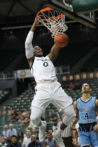 Charlotte's Jailan Haslem (0) hammers it against Rhode Island at the Stan Sheriff Center in Honolulu, Hawaii on December 23, 2018.  Haslem is a 6-10 center from Georgia.