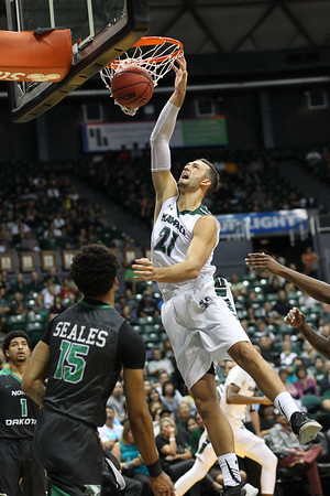 Hawaii forward Gibson Johnson (21) dunks against North Dakota at the Stan Sheriff Center, Honolulu, Hawaii on November 12, 2017. Johnson was a 6-8 player from Centerville, Utah who was a team captain for his senior year. He returned to Hawaii as a graduate manager in the 2019-20 season.