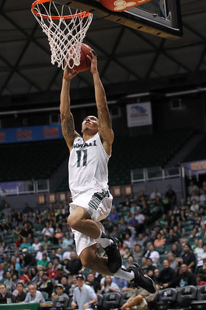 Hawaii's Quincy Smith (11) goes up against Chaminade in exhibition action at the Stan Sheriff Center, Honolulu, Hawaii on November 05, 2015. Smith was a 6-1 guard from Antioch, California who would later score a career-high 19 points in Hawaii's NCAA Tournament first round win over California.
