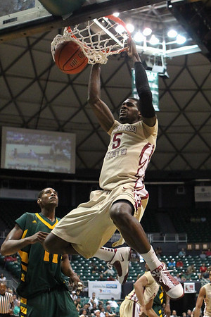 Florida State's Bernard James (5) dunks as Baylor's J'mison Morgan (11) looks on in the third place game of the Diamond Head Classic at the Stan Sheriff Center in Honolulu, Hawaii on December 25, 2010. He would be drafted in the 2nd round, 33rd overall, to the Cleveland Cavaliers in the 2012 NBA draft.
