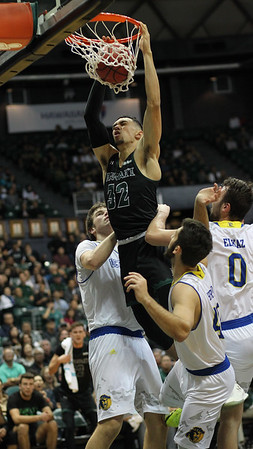 Sophomore Samuta Avea (32) of Hawaii slams against UCSB at the Stan Sheriff Center in Honolulu, Hawaii on February 16, 2019.