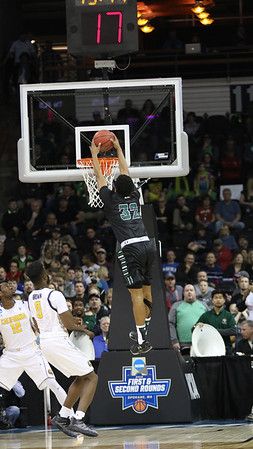 Hawaii's Aaron Valdes (32) soars for the slam as UH defeats Cal, 77-66, in the first round of the 2016 NCAA Basketball Tournament at Spokane Veteran's Arena, Spokane, Washington on March 18, 2016. This was Hawaii's first-ever NCAA Tournament win.