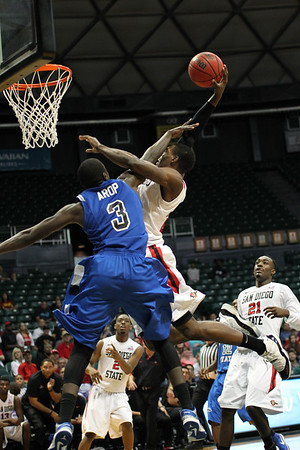 San Diego State forward Deshawn Stephens (23) hammers one home against Indiana State on despite a hand in his face at the Diamond Head Classic in Honolulu, Hawaii on December 23, 2012.