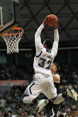 Hawaii guard Brandon Spearman (32) soars for the dunk as UH defeats Omaha, 77-73, at the Stan Sheriff Center, Honolulu, Hawaii on January 3, 2014. Spearman was a 6-3 guard from Chicago who has played in Europe after completing his college career.