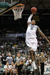 Joston Thomas (5) soars for a breakaway dunk against the Chaminade Silverswords in his first game as a Rainbow Warrior at the Stan Sheriff Center on November 6, 2010, in Honolulu, Hawaii. Thomas was a 6-7 forward from Washington, D.C. who would play one more season with Hawaii before foregoing his senior year.