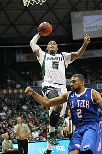 Hawaii's Joston Thomas (5) skies for a ferocious dunk over Louisiana Tech's Brandon Gibson (2) at the Stan Sheriff Center on January 19, 2012, in Honolulu, Hawaii.