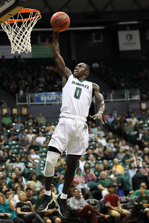 Hawaii's Leland Green (0) looks determined in this dunk against North Dakota at the Stan Sheriff Center, Honolulu, Hawaii on November 12 2017. Green, a 6-2 guard from Los Angeles, was yet another player to leave Hawaii before his senior season.
