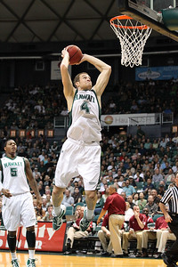 Hawaii forward Bill Amis (4) throws down a two-handed slam against New Mexico State on February 26, 2011, at the Stan Sheriff Center in Honolulu, Hawaii. Amis was a 6-9 senior forward out of Oklahoma City, Oklahoma who finished fifth all-time in blocks at the University of Hawaii.