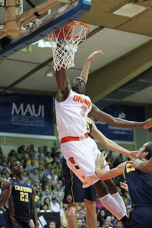 Syracuse forward Jerami Grant (3) dunks over the Californai defense at the EA Sports Maui Invitational at the Lahaina Civic Center, Lahaina, Hawaii on November 26, 2013. The son of former NBA player Harvey Grant, Jerami would be drafted 39th overall to the Philadelphia 76ers.