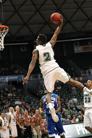 Garrett Jefferson (2) of Hawaii soars for a one-handed dunk against New Orleans at the Stan Sheriff Center in Honolulu, Hawaii on February 13, 2012. Jefferson, a 6-3 guard out of Lakewood, California would play two seasons at UH but left before his senior season.