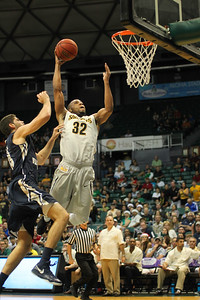 Tekele Cotton (32) of the Wichita State Shockers dunks against the George Washington Colonials in the championship of the Diamond Head Classic held at the Stan Sheriff Center, Honolulu, Hawaii on December 25, 2014.